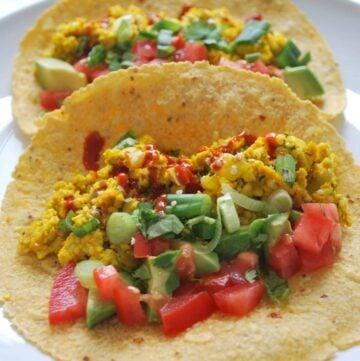a plate with scrambled tofu tacos