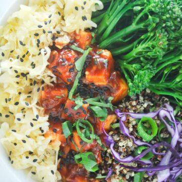 korean bbq tofu bowl. Tofu with a spicy gochujang bbq sauce with broccolini and quinoa #tofu #korean #gochujang #easy #asian #quinoa #weeknight #vegan #vegetarian