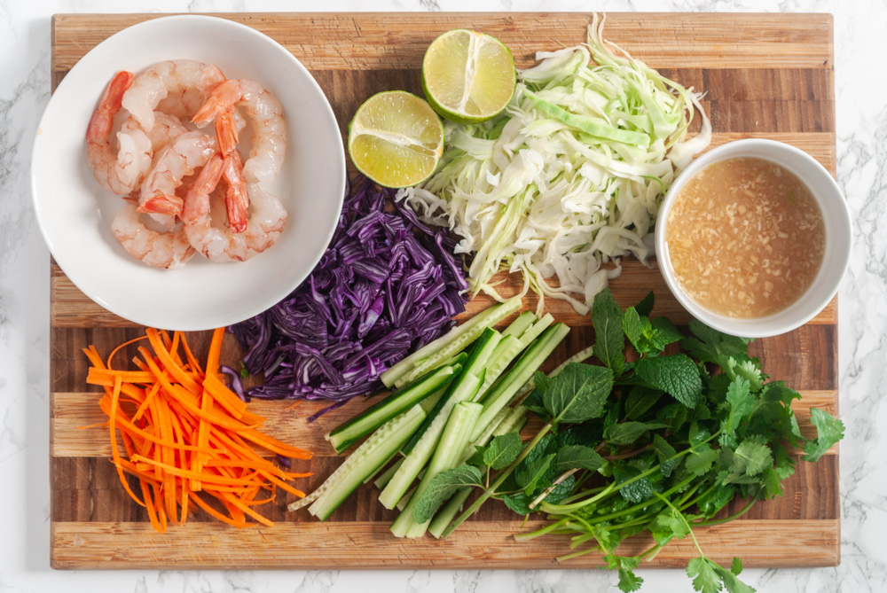 ingredients for Vietnamese shrimp salad chopped on a cutting board