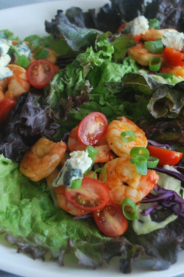 Pan fried shrimp in spicy Buffalo sauce with cilantro lime slaw and blue cheese #shrimp #wraps #pescatarian #seafood #healthy  #lowcarb #keto #easy