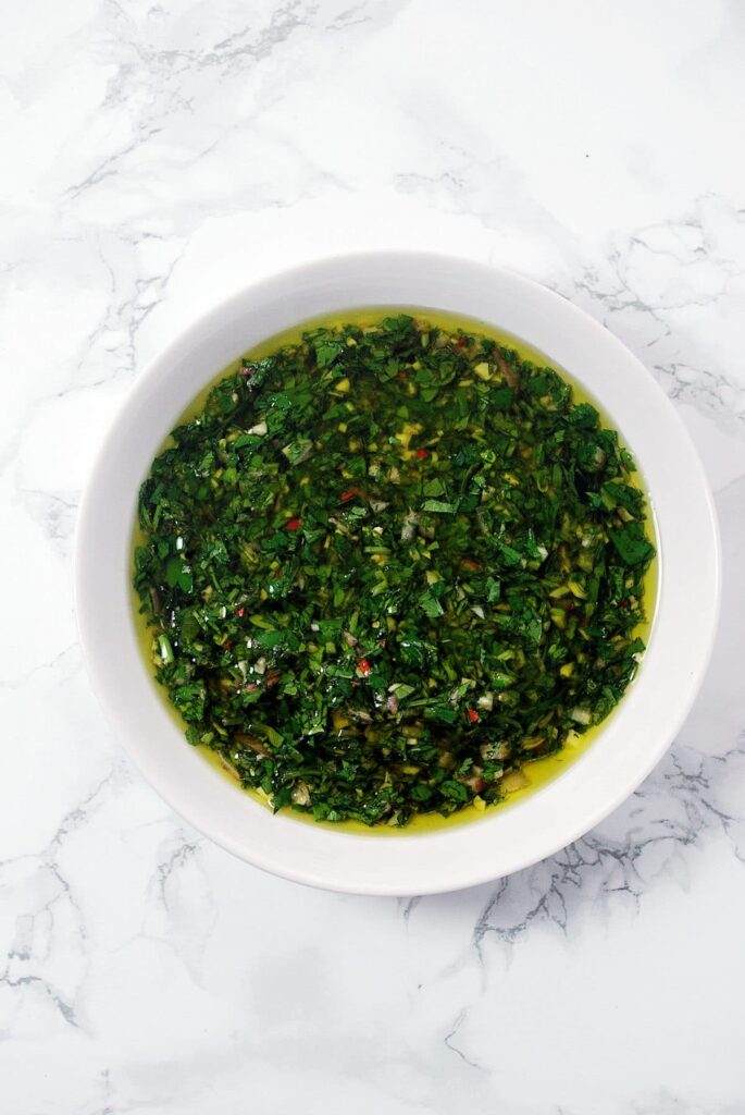 A bowl of fresh chimichurri sauce