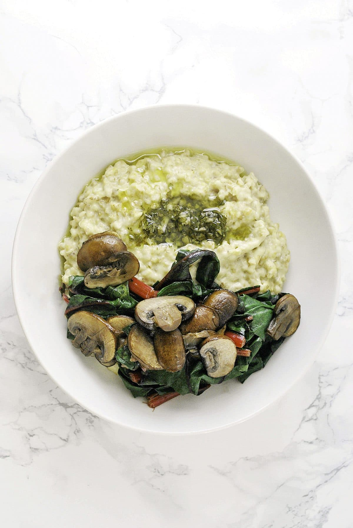 a bowl of chimichurri oats with mushrooms and swiss chard