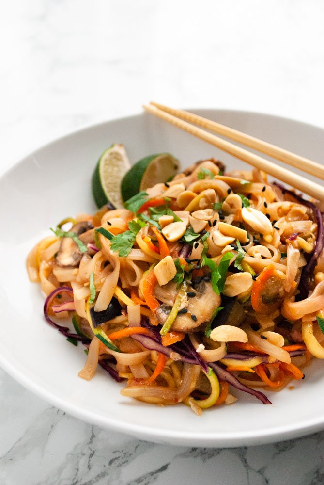 vegetable pad thai in a bowl on a table