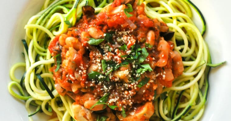 delicious and healthy vegan puttanesca zoodles with white beans and artichoke hearts