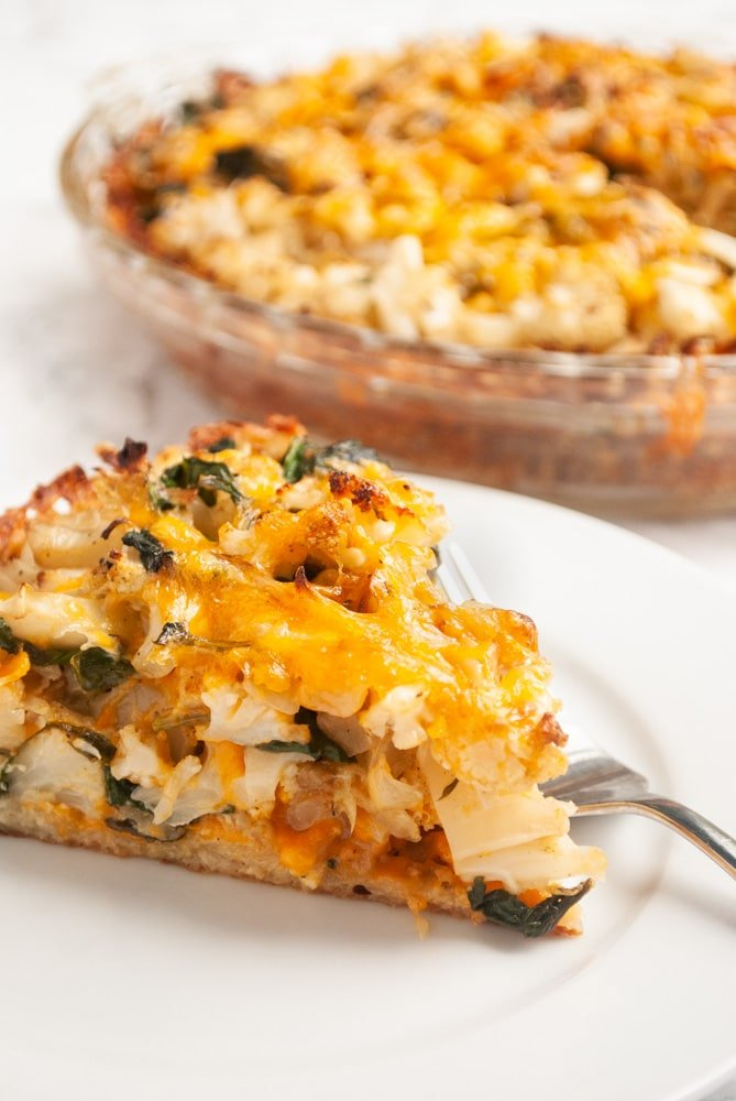 A delicious vegetarian pie filled with cauliflower, cheese and spinach with a potato crust