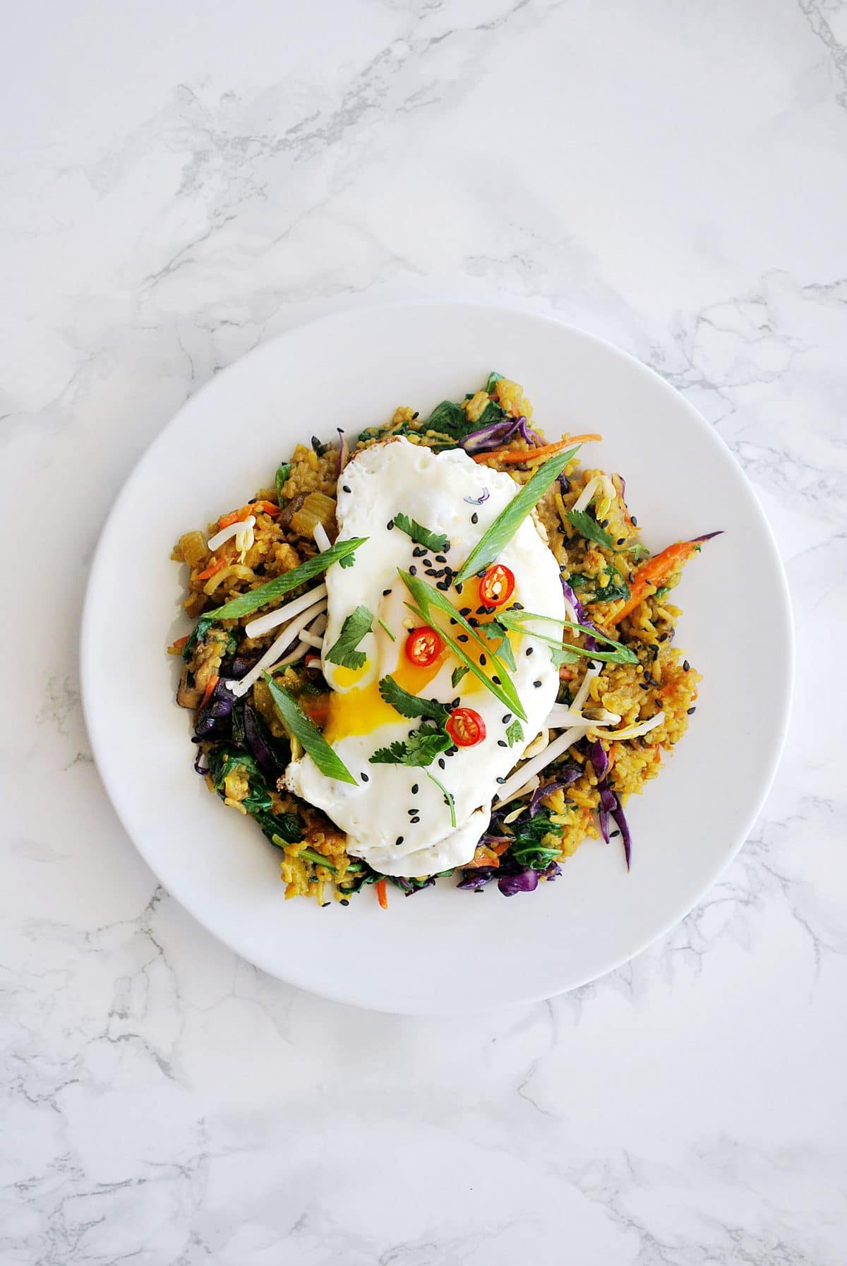 A top down view of a plate of nasi goreng.