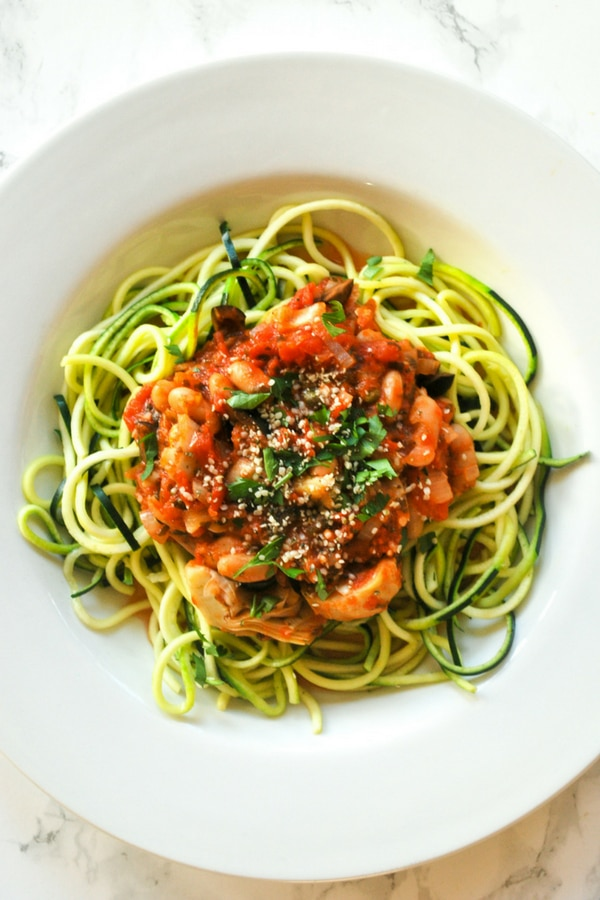 delicious vegan puttanesca sauce with white beans on zucchini noodles