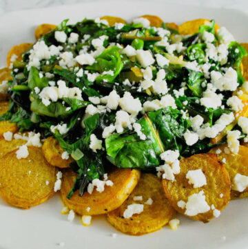 roasted golden beets with wilted greens topped with feta cheese
