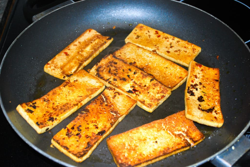 perfectly cooked seared tofu in a frying pan