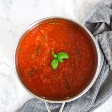 a pot of basic tomato sauce with basil and garlic