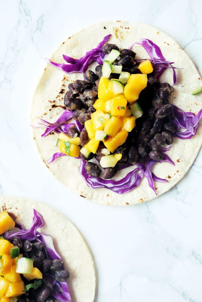 jerk black bean tacos with mango cucumber salsa