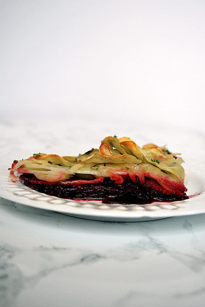 A slice of potato beet boulangere on a plate