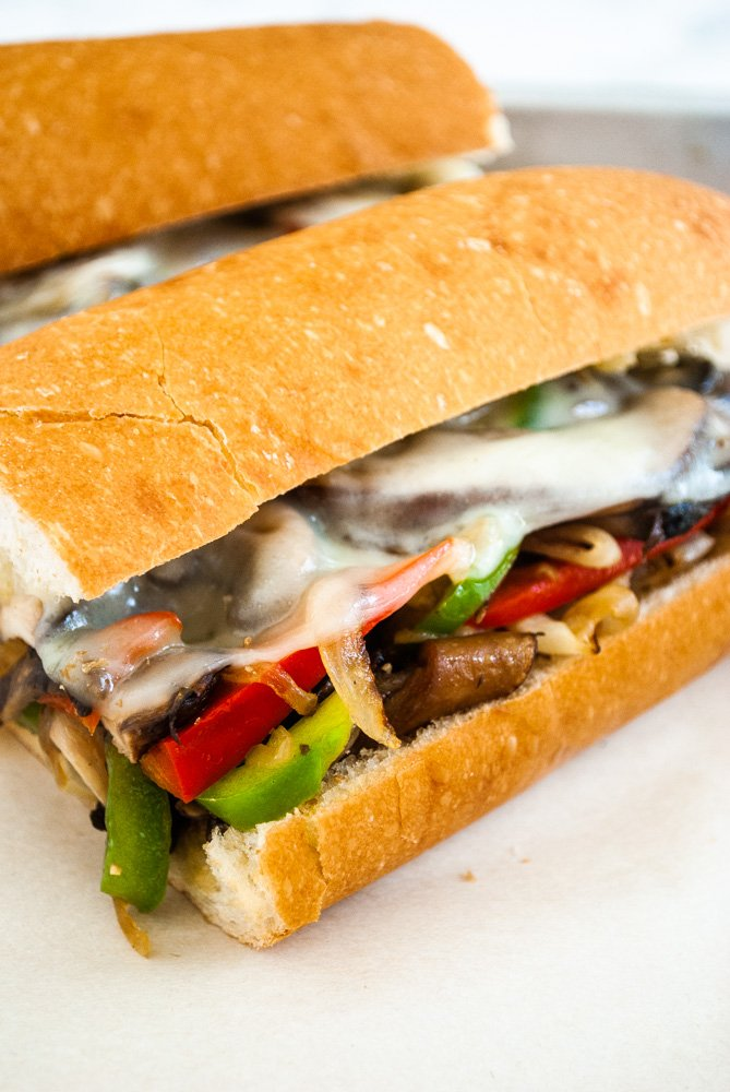 veggie philly cheesesteak sandwiches on a tray