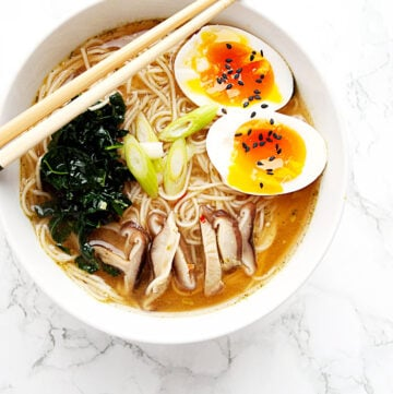 bowl of spicy miso ramen wtih kale, shitake mushrooms and a perfect jammy egg