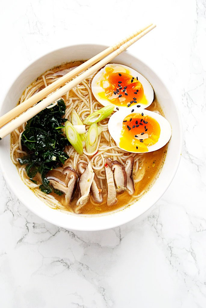 bowl of spicy miso ramen with kale, shitake mushrooms and a perfect jammy egg