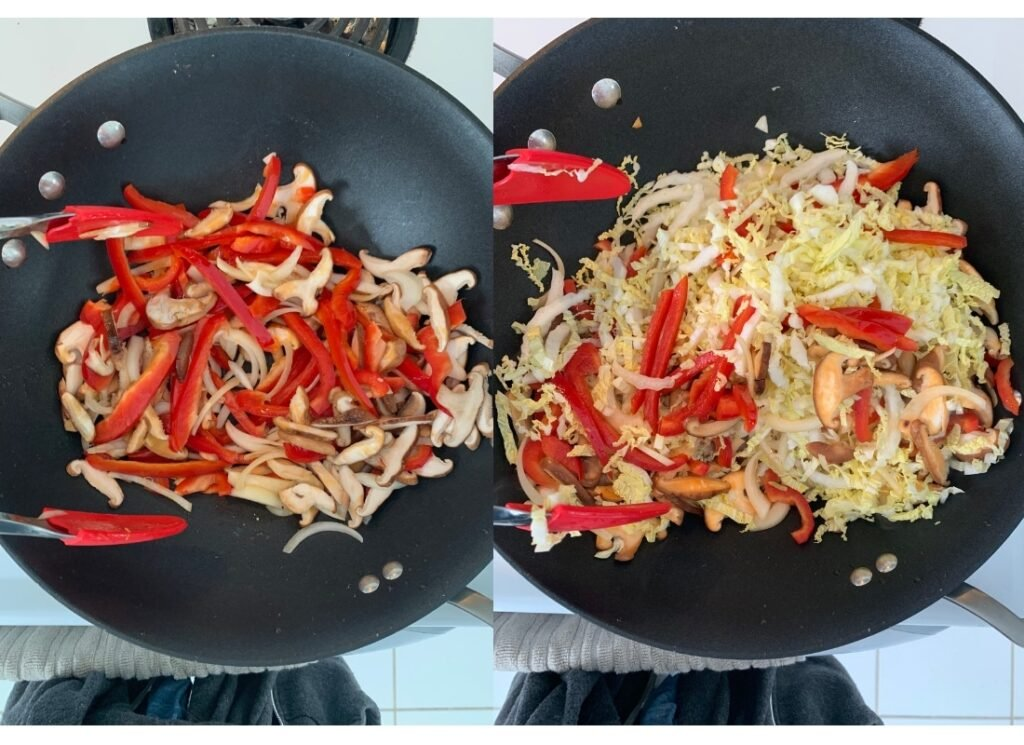 red pepper, shitake mushrooms, onion and napa cabbage stir-frying in a wok
