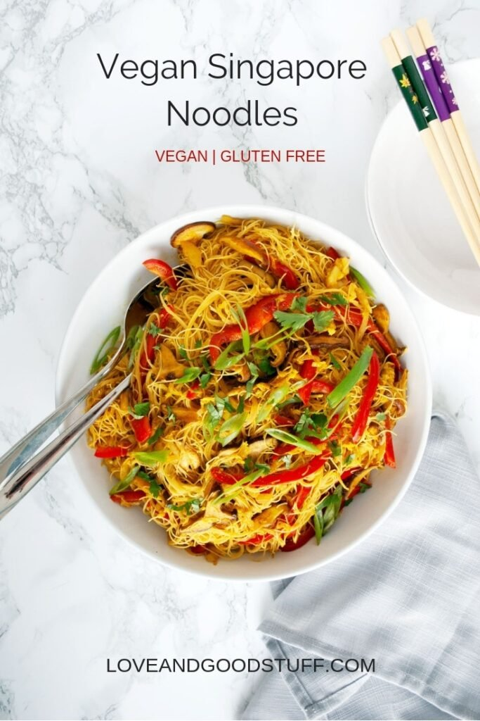 a serving bowl filled with vegan Singapore noodles on a table