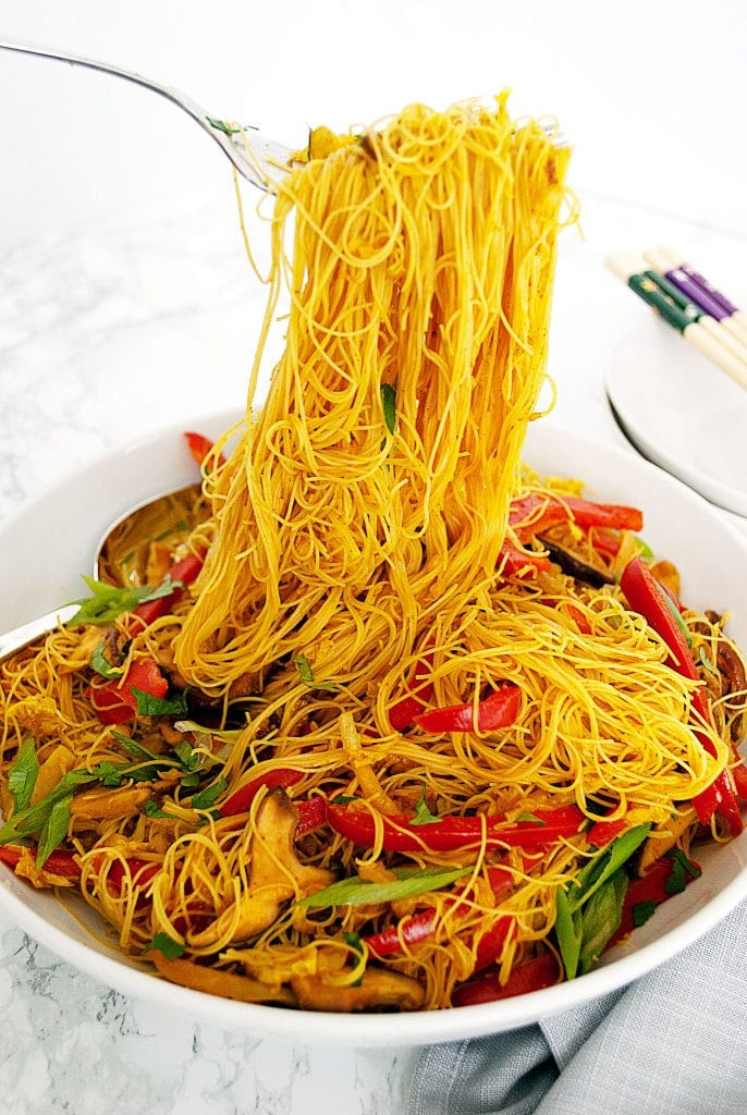 a serving bowl filled with vegan singapore noodles