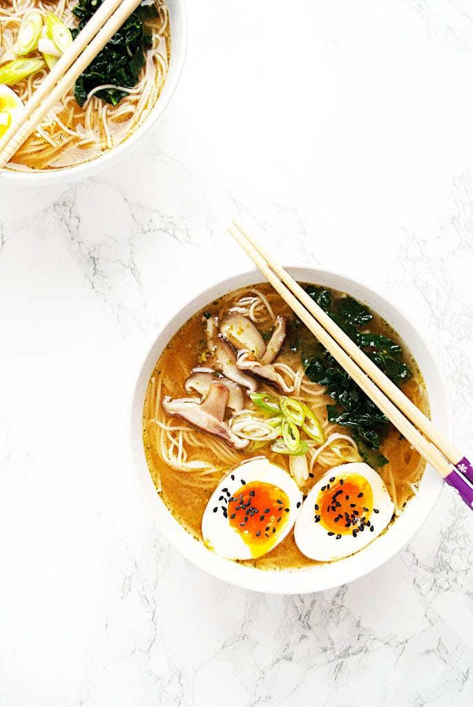 a bowl of vegetarian miso ramen with kale, mushrooms and boiled egg