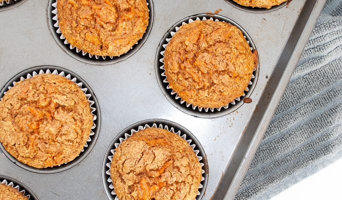 a tray of freshly baked healthy carrot muffins