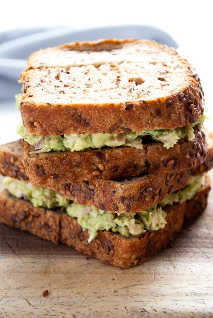a stack of avocado tuna salad sandwiches