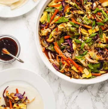a table set with Mandarin pancakes, moo shu vegetables, and a dinner plate ready to eat
