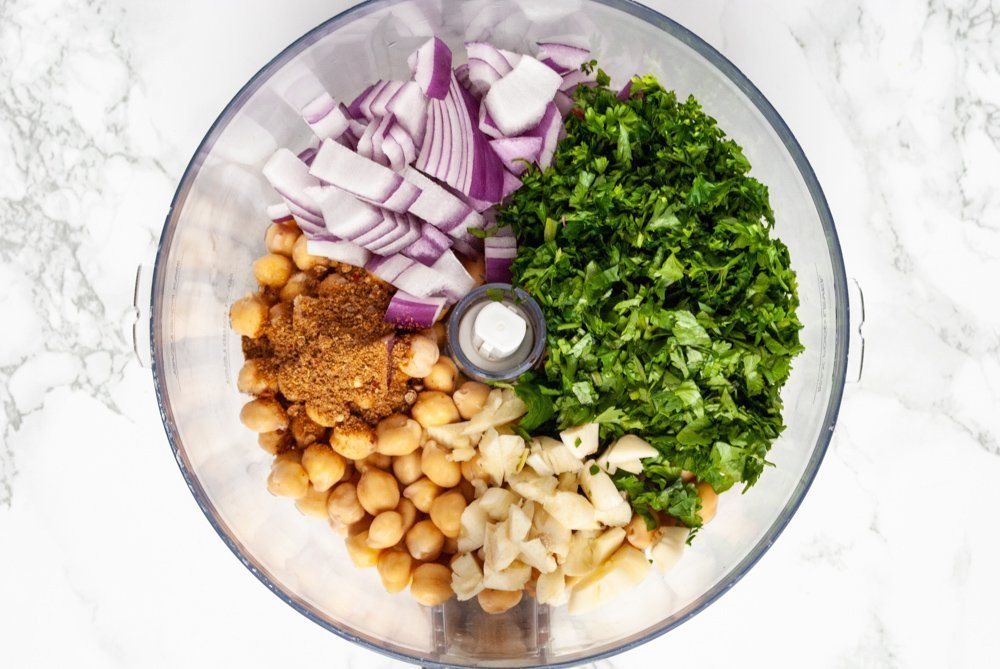 a food processor containing the ingredients for homemade falafel