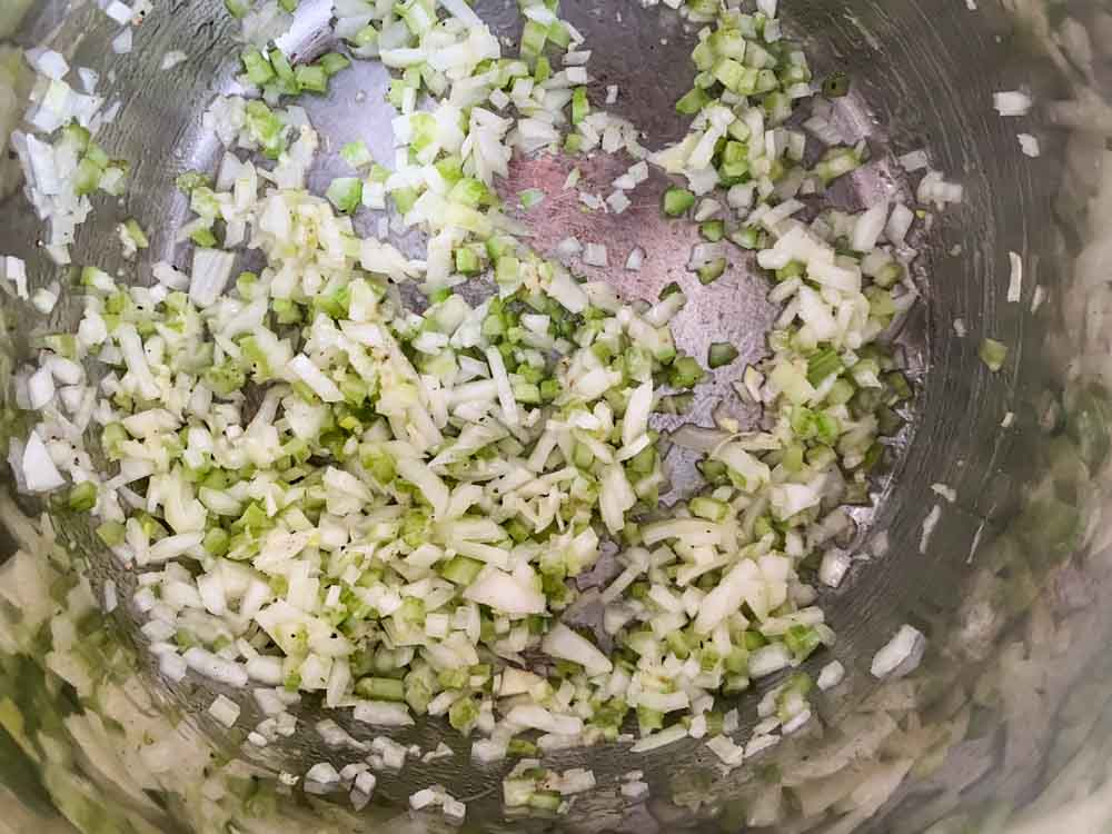 finely diced onion and celery cooking in an Instant Pot