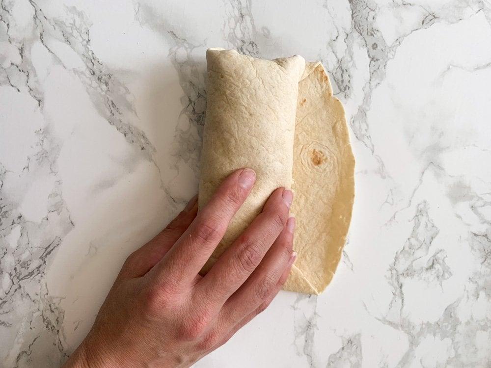 a fully rolled breakfast burritoi