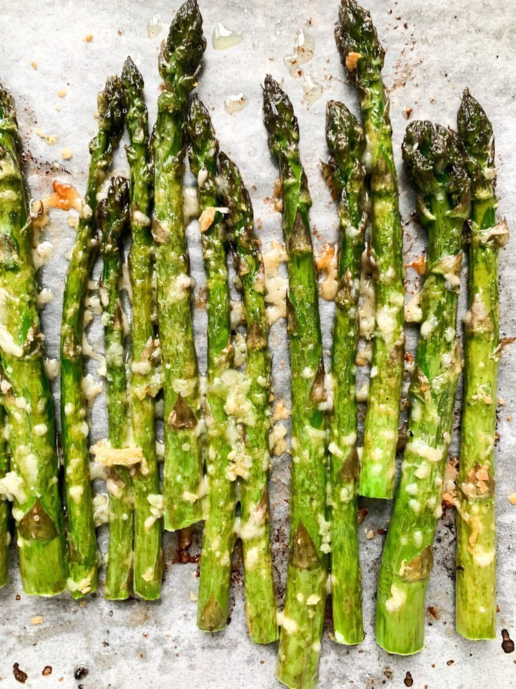 A close up shot of freshly roasted garlic parmesan asparagus.