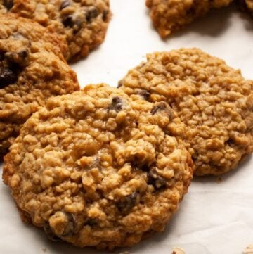 oatmeal chocolate chip cookies on parchment paper