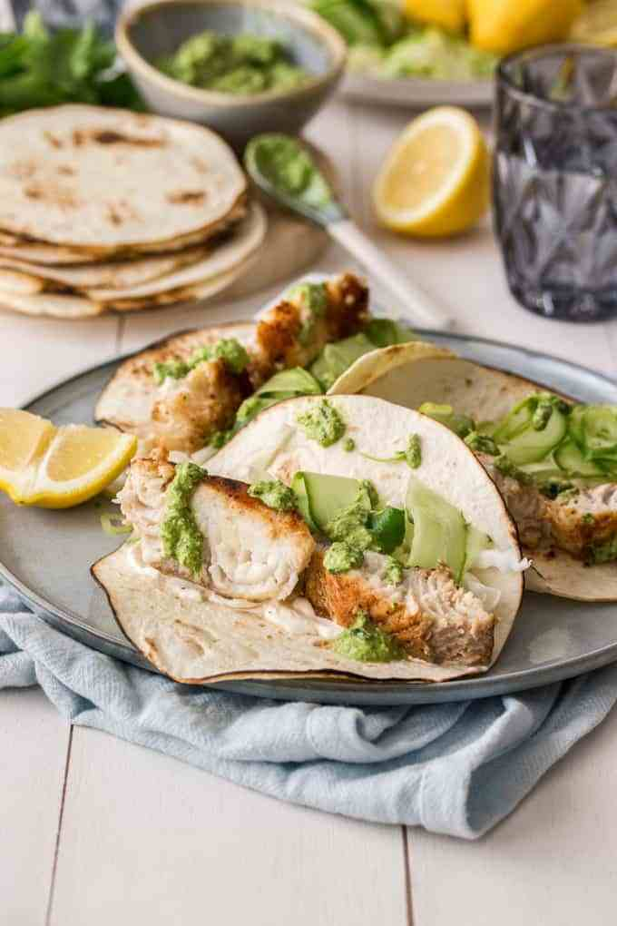 fish tacos with pumpkin seed pesto on a plate