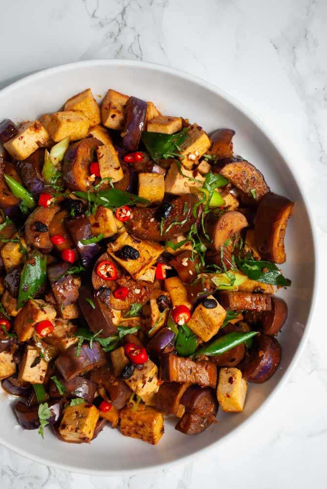 a topdown view of a bowl of spicy black bean tofu and eggplant