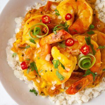 a bowl of durban curry shrimp on cauliflower rice