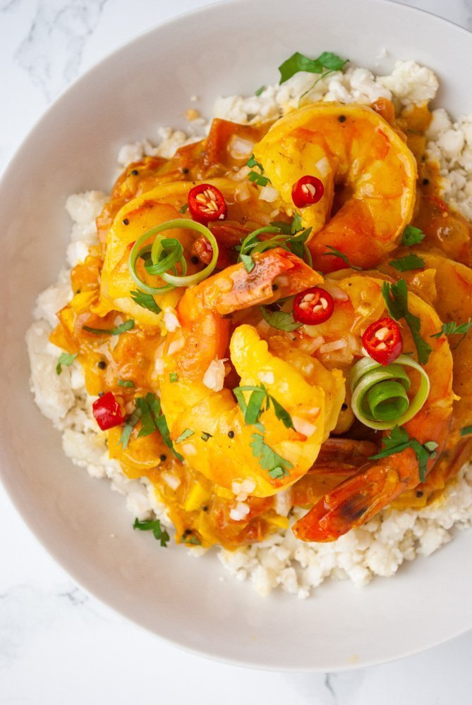 a bowl of durban curry shrimp on cauliflower rice