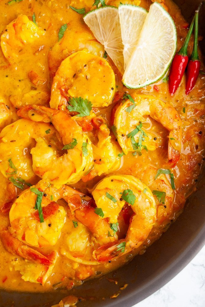 a skillet of freshly cooked Durban curry shrimp