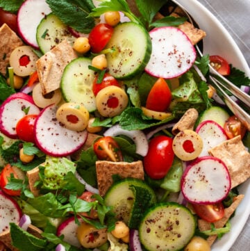 a bowl of fattoush salad with chickpeas