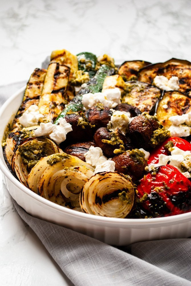 grilled vegetables topped with pesto and goat cheese