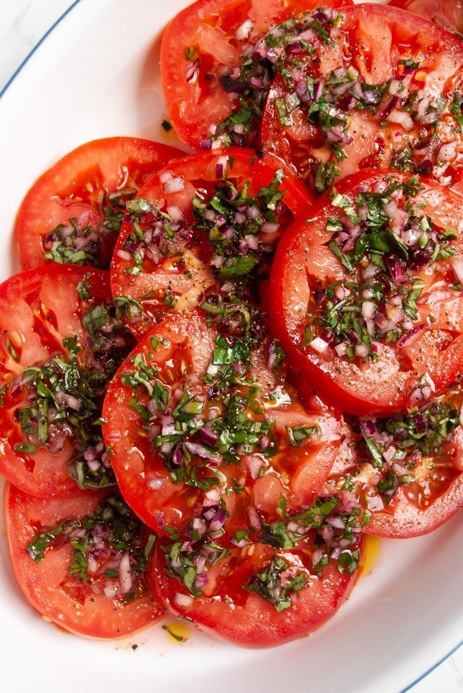 a plate of marinated tomato salad
