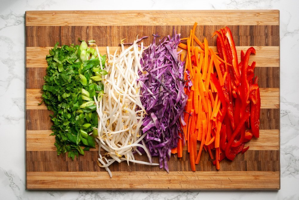 chopped vegetables prepped on a cutting board