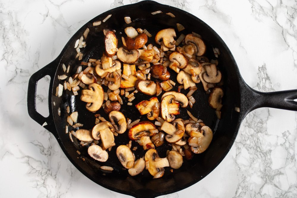 cooked onions and mushrooms in a skillet