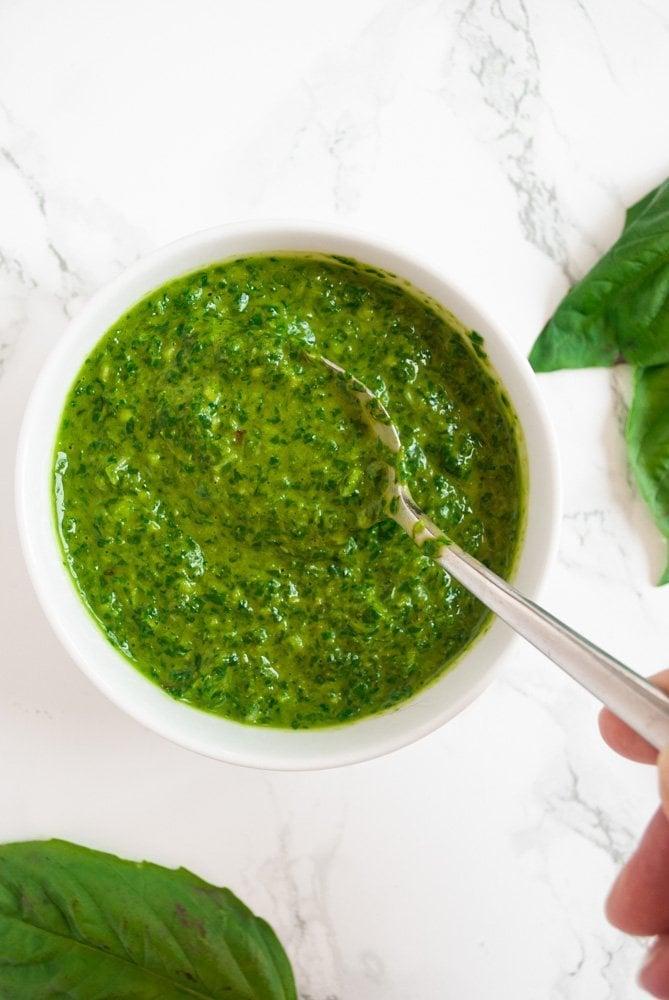 a bowl of basil sauce