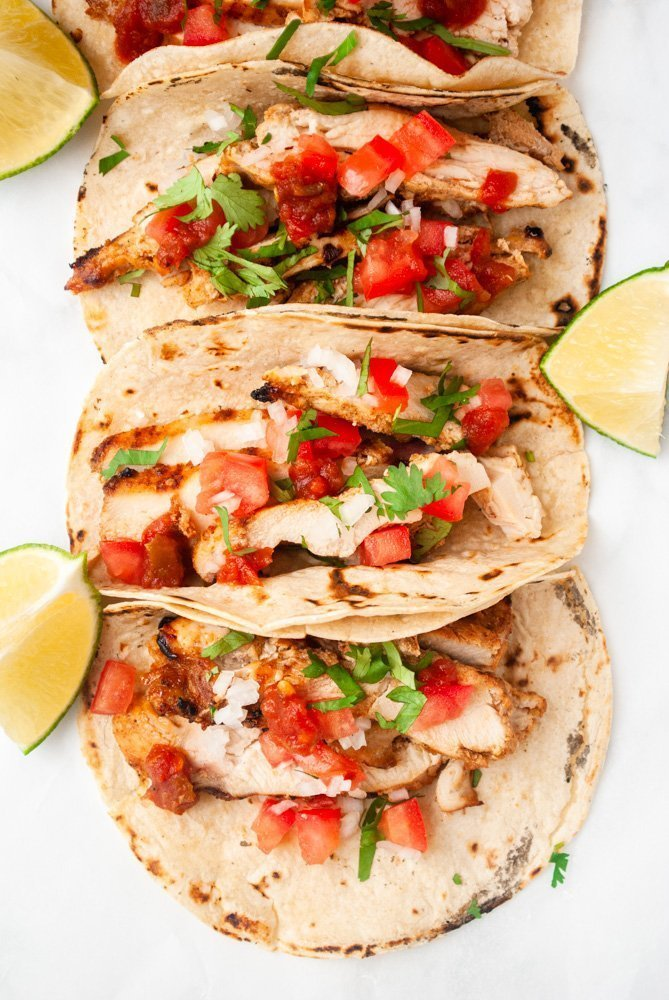 a topdown view of several grilled chicken tacos