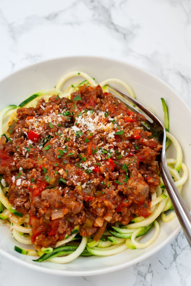 A bowl of sausage ragu served over zucchini noodles.