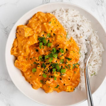 a bowl of tofu tikka masala on rice