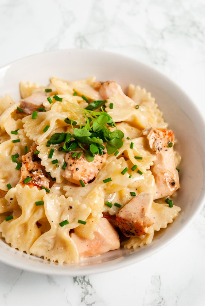 a bowl of creamy salmon pasta