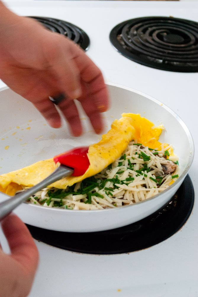 folding the omelette over