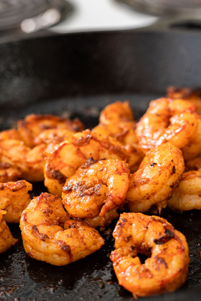 cooked spiced shrimp in a skillet