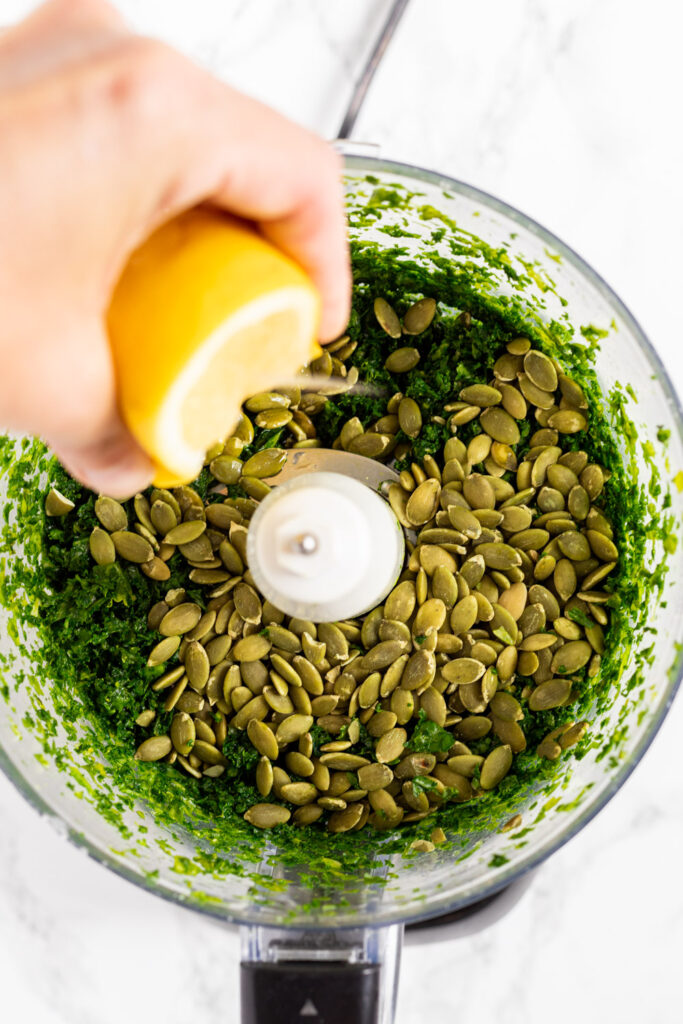 making kale pesto in a food processor