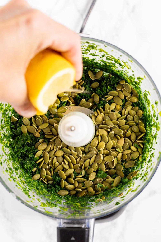 making kale pesto in a food processor